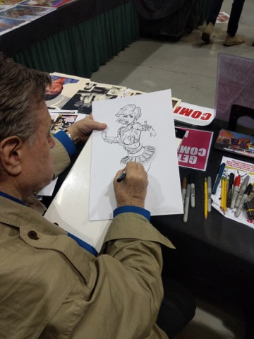 Neal Adams working on DollFace cover